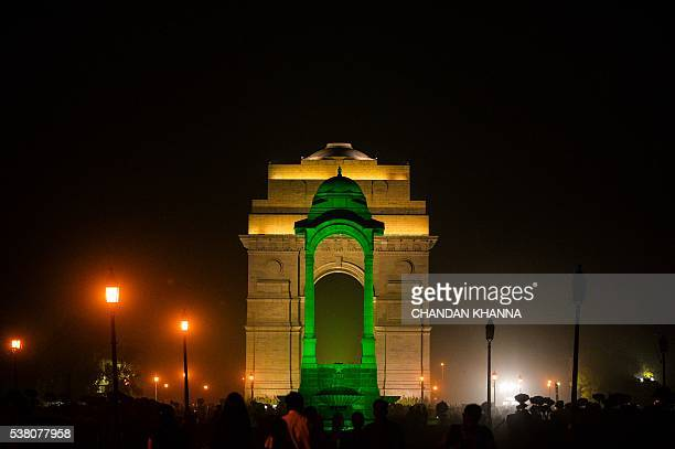 The empty canopy with India Gate in the background is lit green to support planting trees and going green on the eve of World Environment Day in New...