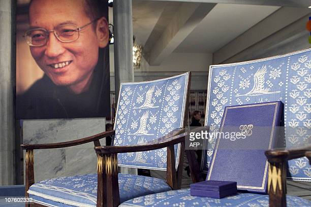 The empty chair with a diploma and medal that should have been awarded to this year's Nobel Peace Prize winner Liu Xiaobo stands in Oslo City Hall on...