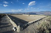 The empty Manzanar reservoir is seen against the background of the Eastern Sierra mountains August 2 at the WW II era Manzanar internment camp in...