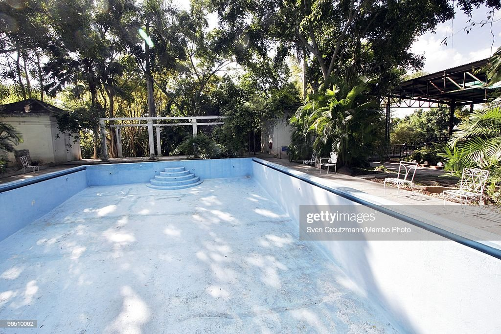 The empty pool next to Ernest Hemingway�s house at the Finca Vigia, on January 6, 2007 in Havana, Cuba. The Hemingway Finca Vigia, now turned into a museum, has been restored with joint efforts of American and Cuban scientists and historians. Between 1939 and 1960, the American writer and journalist lived for many years in Cuba. It was here where he wrote his novel The Old Man and the Sea, which earned him both the Pulitzer Prize and the Nobel Prize in Literature.