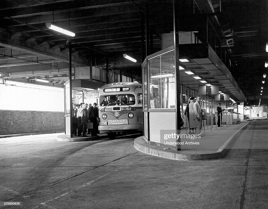 The enclosed loading platform at the Port Authority Bus Terminal being used by passengers boarding a bus for Maplewood New York New York May 1 1963