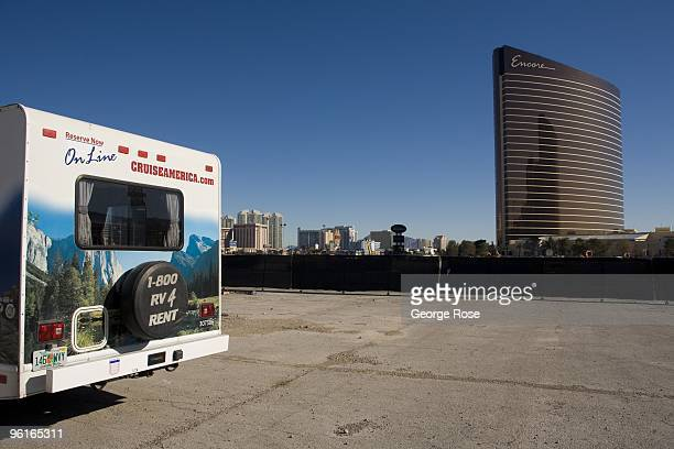 The Encore Hotel Casino stands out against a stark empty building lot and 'Cruise America' motorhome as seen in this 2009 Las Vegas Nevada winter...