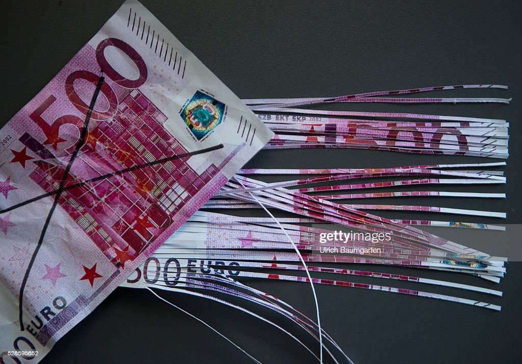 The end of the 500 euro banknote. The photo shows a strikethough and a shredded 500 euro banknote.