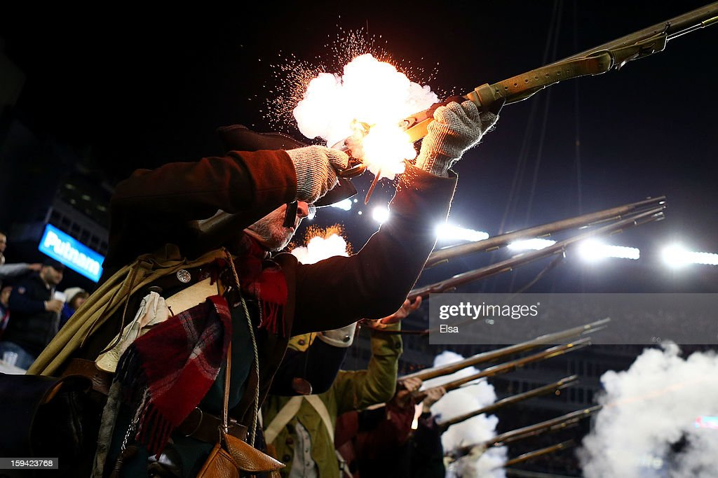 The 'End Zone Militia' of the New England Patriots fire their guns during the 2013 AFC Divisional Playoffs game at Gillette Stadium on January 13, 2013 in Foxboro, Massachusetts.