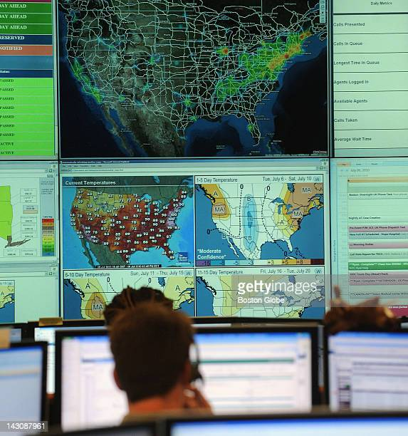 The EnerNOC monitoring wall board at the company's operation center in Boston on July 6 shows maps displaying energy usage/ heat density The redder...