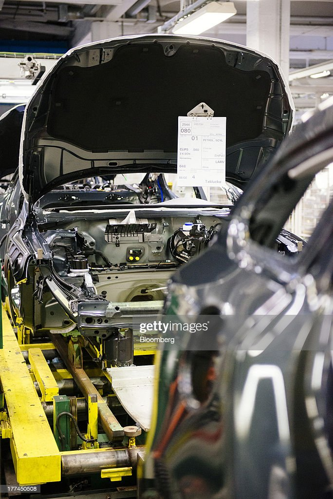 The engine bay of a Volvo S60 vehicle is seen before a motor is attached at the Volvo Cars plant in Torslanda, Sweden, on Thursday, Aug. 22, 2013. Volvo Cars Chief Executive Officer Hakan Samuelsson will settle a German investigation into corruption allegations linked to his tenure as MAN SE's CEO by paying 500,000 euros ($668,000) to charity. Photographer: Kristian Helgesen/Bloomberg via Getty Images