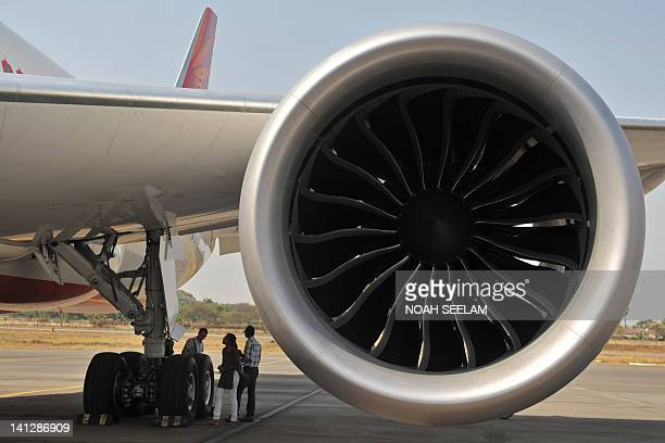 The engine cowling of a newly inducted Air India Boeing 7878 series Dreamliner aircraft is seen on static display during the opening day of India...