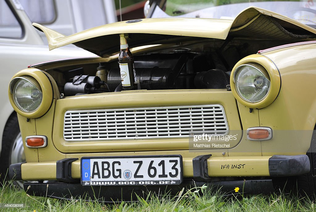 The engine cowling of a Trabant 601 car is held by a beer bottle as fans of the East German Trabant car gather for their 7th annual get-together on August 23, 2014 in Zwickau, Germany. Hundreds of Trabant enthusiasts arrived to spend the weekend admiring each others cars, trading stories and enjoying activities. The Trabant, dinky and small by modern standards, was the iconic car produced in former communist East Germany and today has a strong cult following.