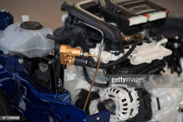 The engine of a SEAT Ibiza TGI hybrid automobile sits on display during the Volkswagen AG compressed natural gas Mobility Day in Essen Germany on...