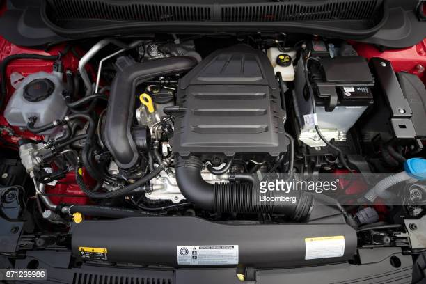 The engine of a Volkswagen AG Polo TGI compressed natural gas fueled automobile sits on display during VW's CNG Mobility Day in Essen Germany on...