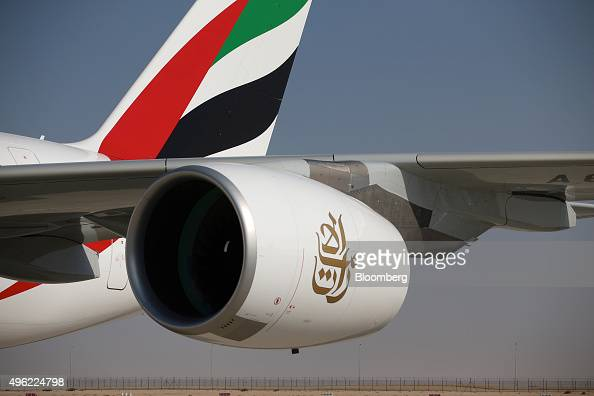 The engine of an Airbus SAS A380800 aircraft hangs from the wing of an Emirates Airline aircraft on the opening day of the 14th Dubai Air Show at...