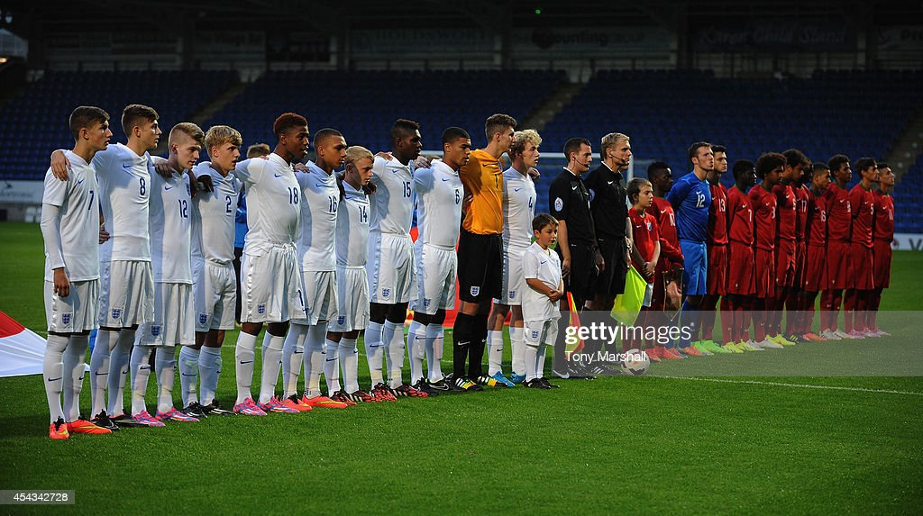 The England and Portugal teams line up for the national anthem prior to the Under 17 International match between England U17 and Portugal U17 at Proact Stadium on August 29, 2014 in Chesterfield, England.