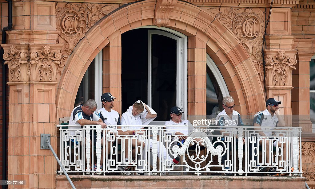 The England balcony with captain Alastair Cook (2nd left) Joe Root (3rd left) coach Peter Moores ( 2nd right) and Matt Prior look on during day five of 2nd Investec Test match between England and India at Lord's Cricket Ground on July 21, 2014 in London, United Kingdom.