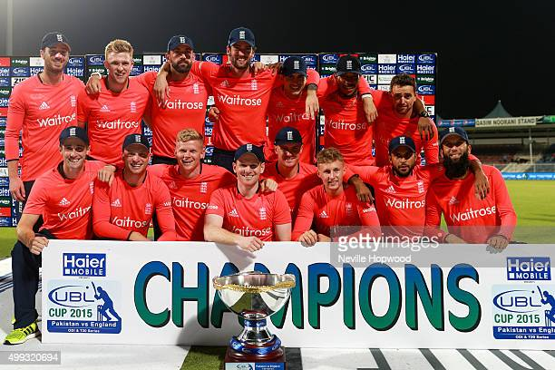 The England Cricket Team celebrate winning the UBL T20 Cup during the 3rd International T20 match between Pakistan and England at Sharjah Cricket...