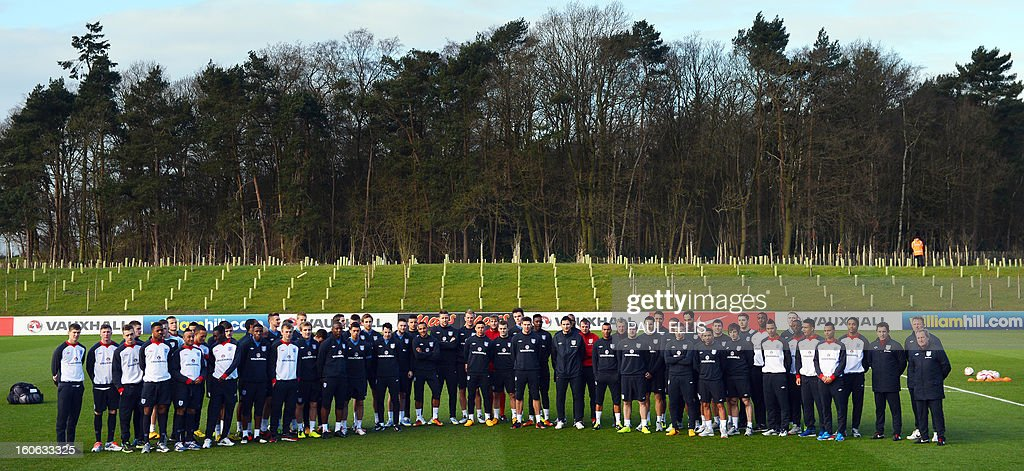 The England football first team squad, the Under 21's and Under 19's stand together for a picture at the St George's Park training complex near Burton-upon-Trent, central England on February 4, 2013. England take on Brazil at Wembley in an international friendly on February 6. AFP PHOTO/Paul Ellis EDITORIAL