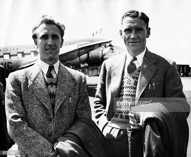 The England Football team leaving on a continental tour Eric Parsons of West Ham and Billy Nicholson of Spurs preparing to fly out of Northolt...