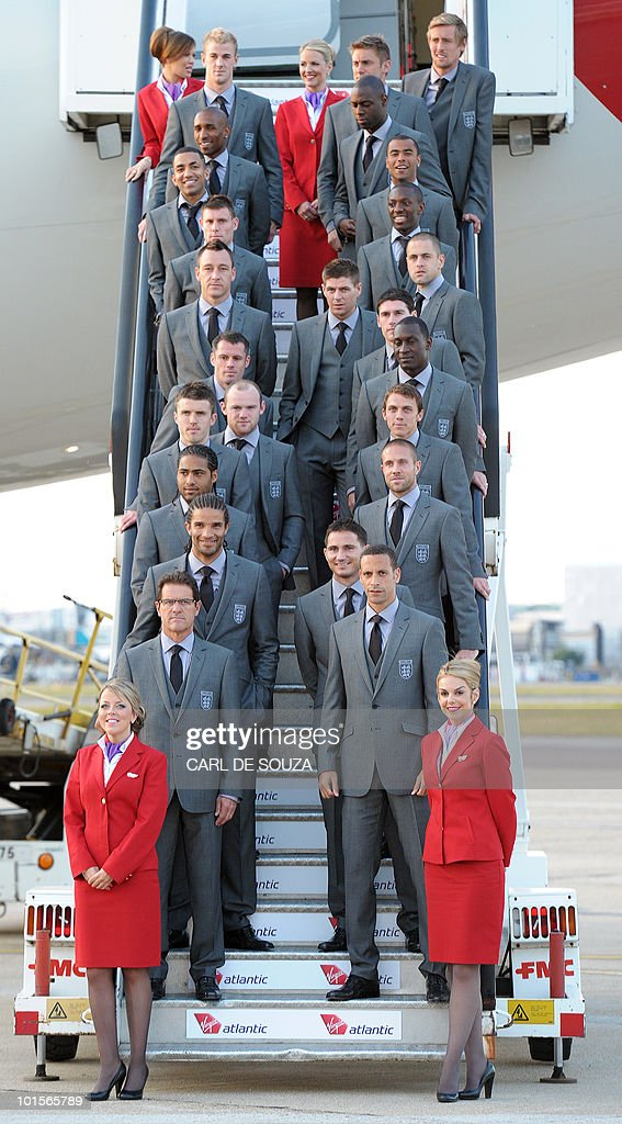 The England football team pose before boarding a plane for South Africa at Heathrow airport, London on June 2, 2010.