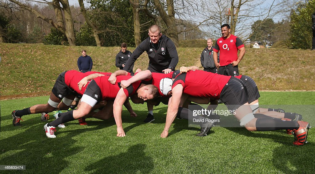 The England forwards practice their scrummaging watched by forwards coach Graham Rowntree during the England training session held at Pennyhill Park...