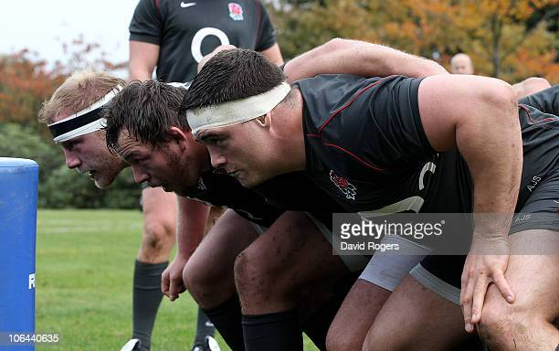 The England front row Dan Cole Steve Thompson and Andrew Sheridan scrummage during the England training session held at Pennyhill Park Hotel on...