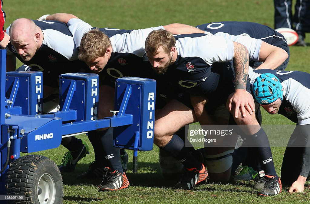 The England front row (L-R) Dan Cole, Tom Youngs and Joe Marler practice on the scrum machine during the England training session at Pennyhill Park on March 14, 2013 in Bagshot, England.