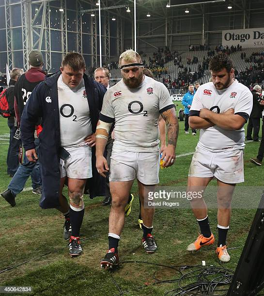 The England front row David Wilson Joe Marler and Rob Webber walk off the field after their defeat during the International Test Match between the...