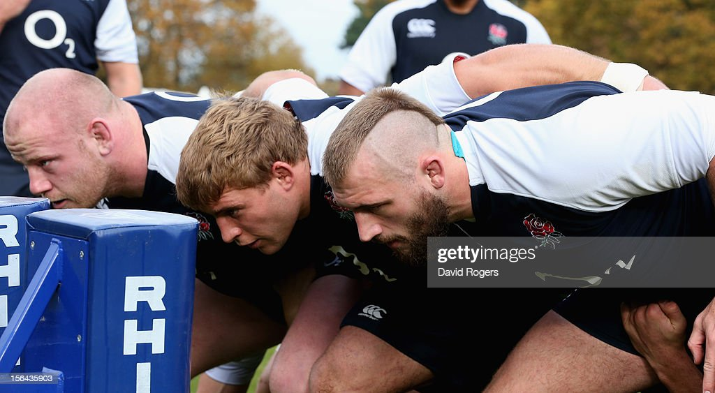 The England front row (R-L) Joe Marler, Tom Youngs and Dan Cole practice scrummaging during the England training session held at Pennyhill Park on November 13, 2012 in Bagshot, England.