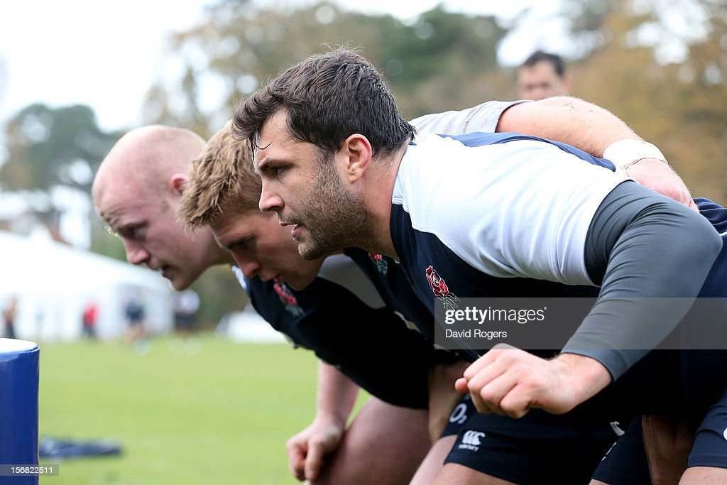 The England front row of Alex Corbisiero, Tom Youngs and Dan Cole prepare to scrummage during the England training session at Pennyhill Park on November 22, 2012 in Bagshot, England.