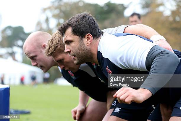 The England front row of Alex Corbisiero Tom Youngs and Dan Cole prepare to scrummage during the England training session at Pennyhill Park on...