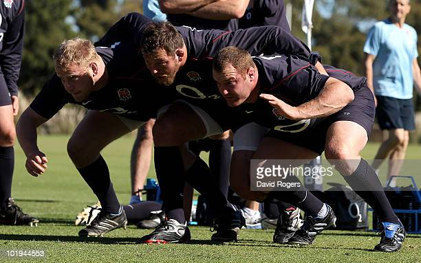the England front row of Dan Cole Steve Thompson and Tim Payne practice their scrummaging technique during a England rugby training session at Hale...