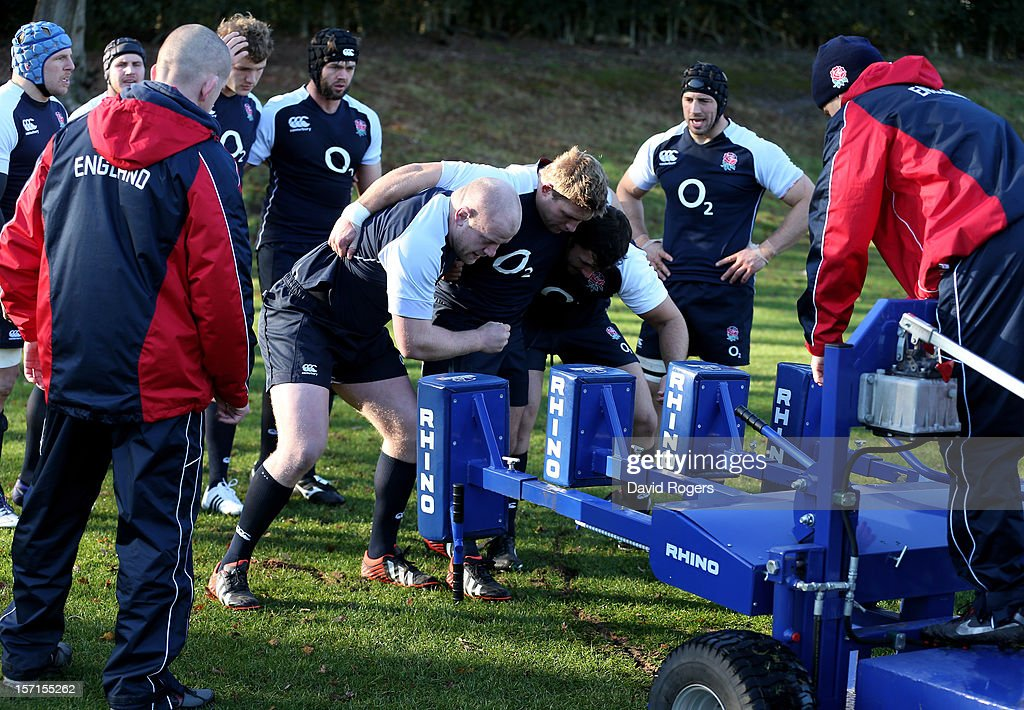 The England front row of Dan Cole, Tom Youngs and Alex Corbisiero prepare to scrummage during the England training session at Pennyhill Park on November 29, 2012 in Bagshot, England.