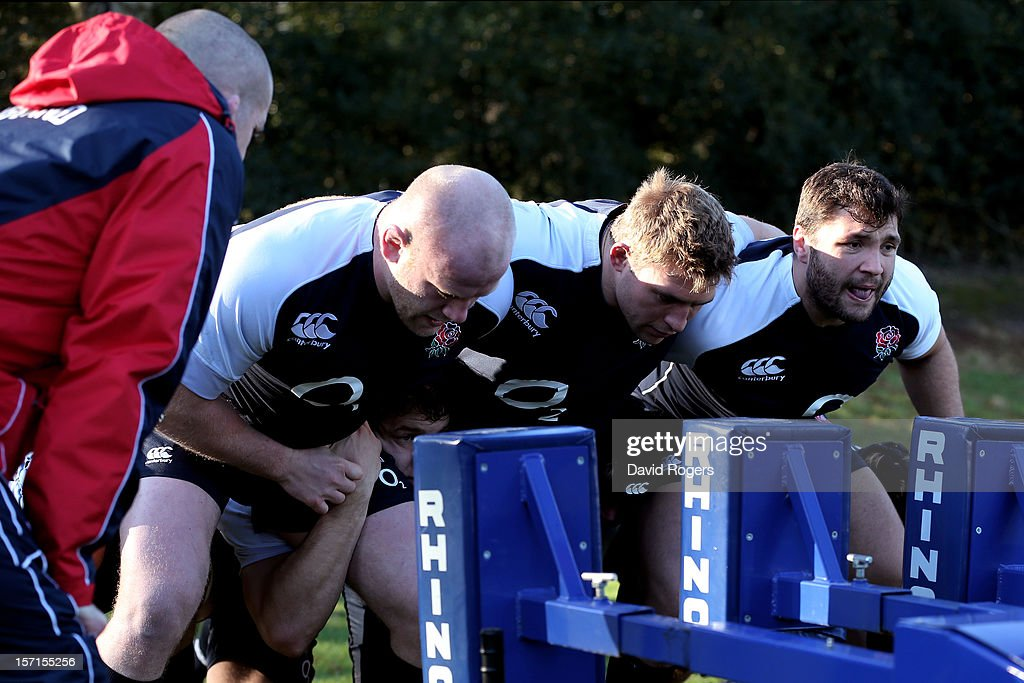 The England front row of Dan Cole, Tom Youngs and AlexCorbisiero prepare to scrummage during the England training session at Pennyhill Park on November 29, 2012 in Bagshot, England.