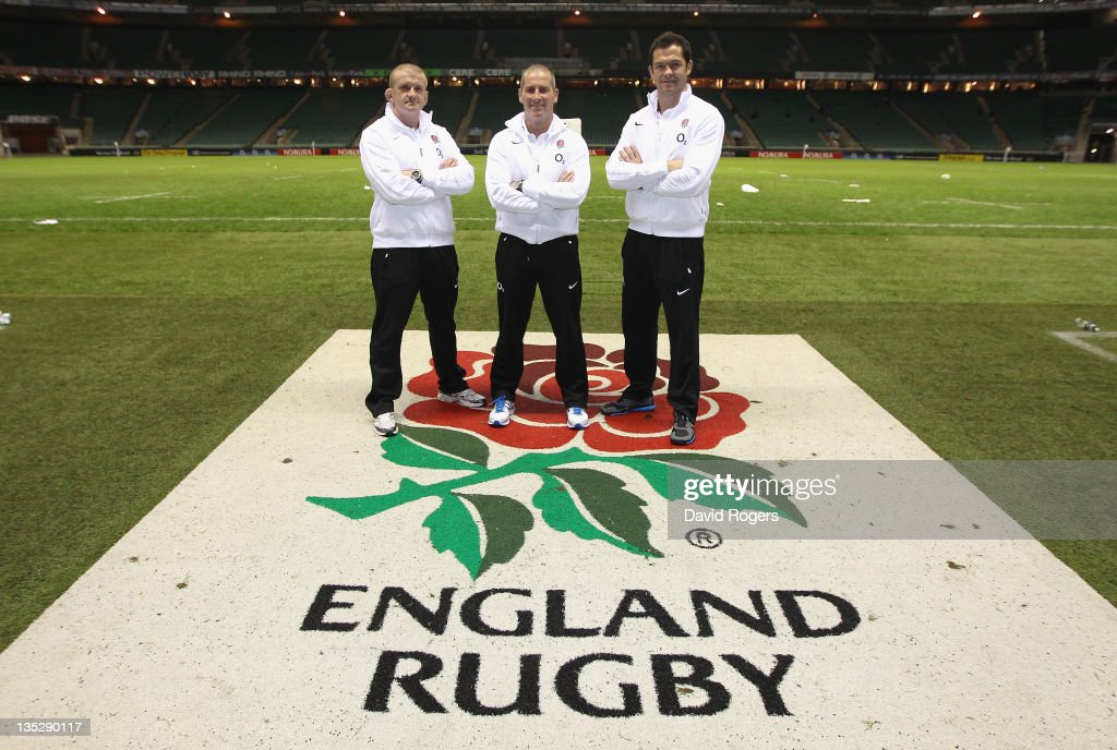 The England interim coaching team of Stuart Lancaster head coach Andy Farrell the backs coach and Graham Rowntree the forwards coach pose after at...