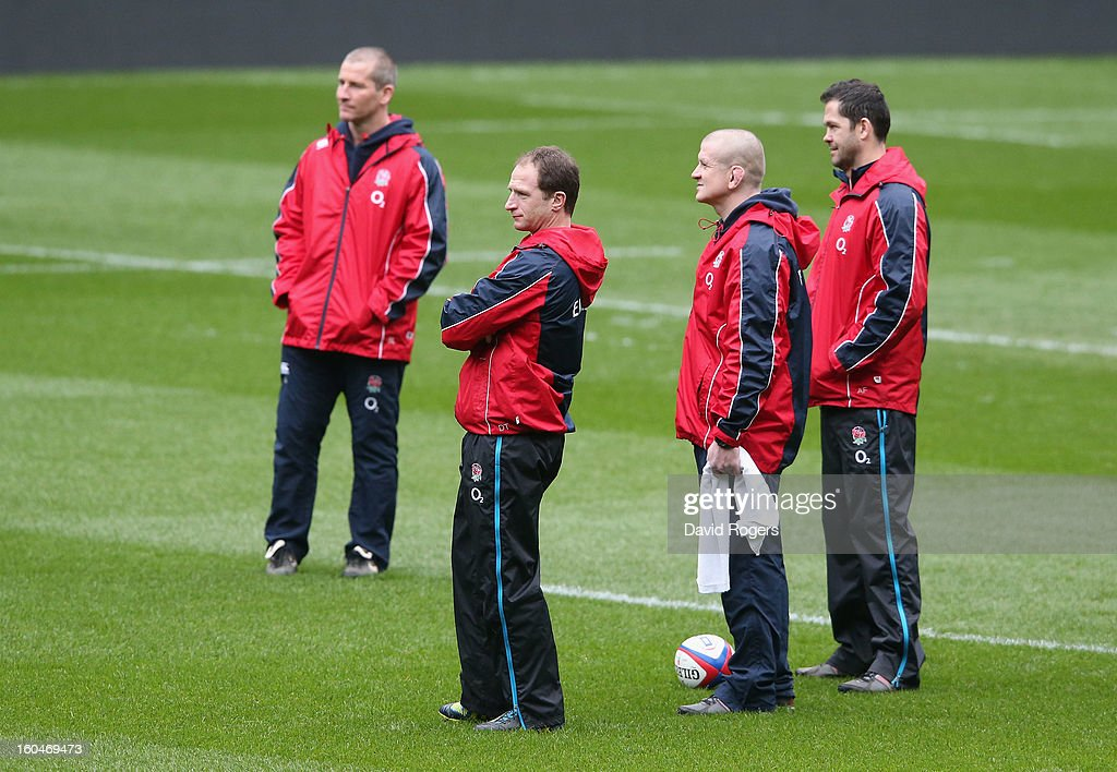 The England management (L-R) Stuart Lancaster, head coach, Mike Catt, skills coach, Graham Rowntree, forwards coach and Andy Farrell, backs coach look on during the England captain's run at Twickenham Stadium on February 1, 2013 in London, England.