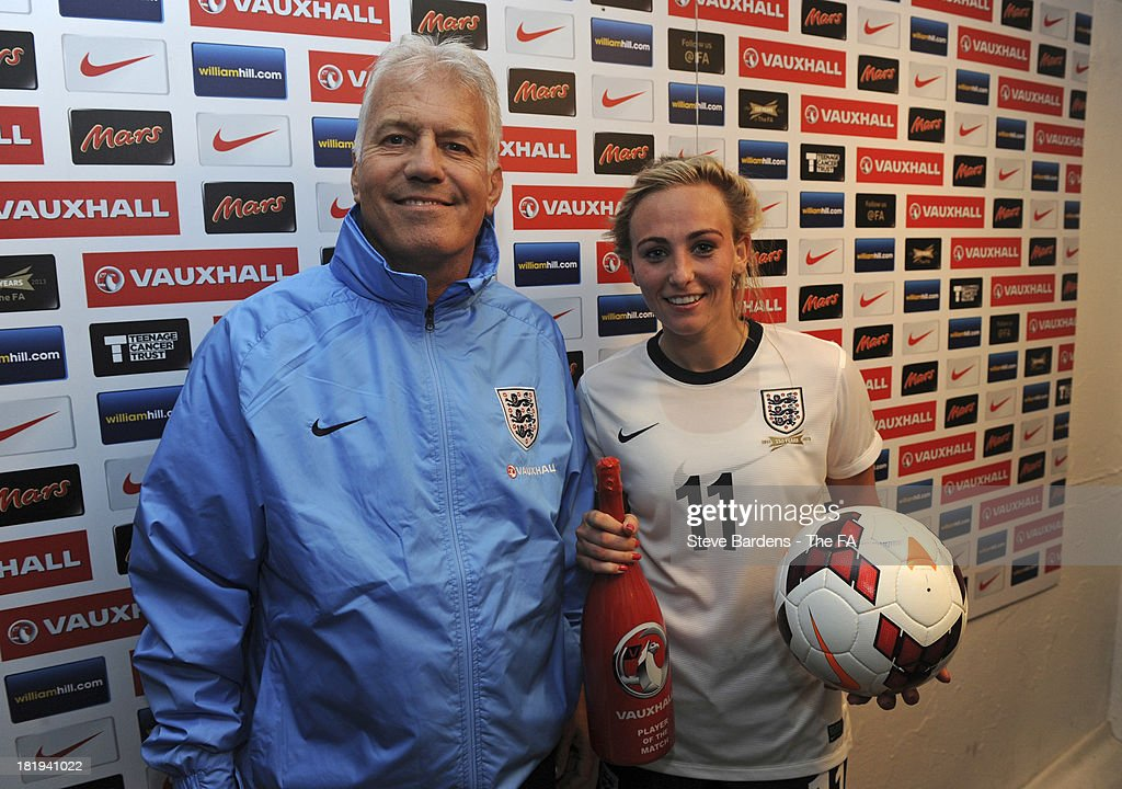 The England Manager Brent Hills with the player of the match Toni Duggan of England after the FIFA Women's World Cup 2015 Group 6 Qualifier between England and Turkey at Fratton Park on September 26, 2013 in Portsmouth, England.