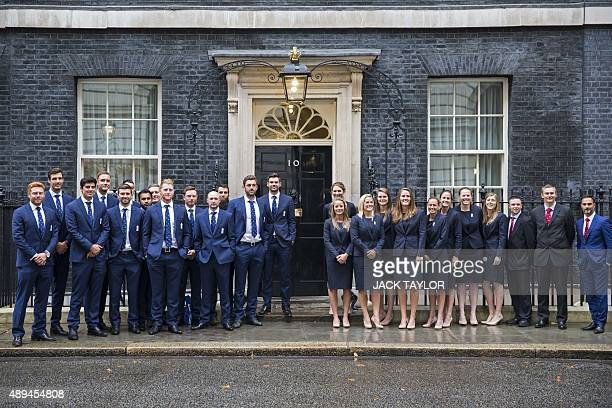 The England men's and women's cricket teams pose for photographers outside 10 Downing Street ahead of a reception in London on September 21 2015 AFP...