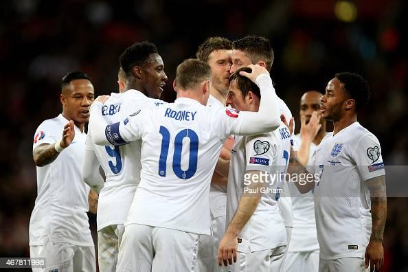 The England players celebrate during the EURO 2016 Qualifier match between England and Lithuania at Wembley Stadium on March 27 2015 in London England