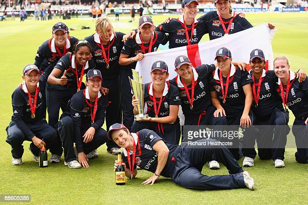 The England players celebrate victory with the trophy at the end of the ICC Women's World Twenty20 Final between England and New Zealand at Lord's on...