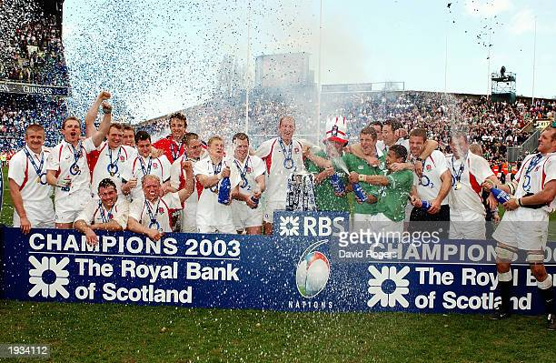 The England players celebrate winning the Grand Slam after the RBS Six Nations Championship match between Ireland and England held on March 30 2003...