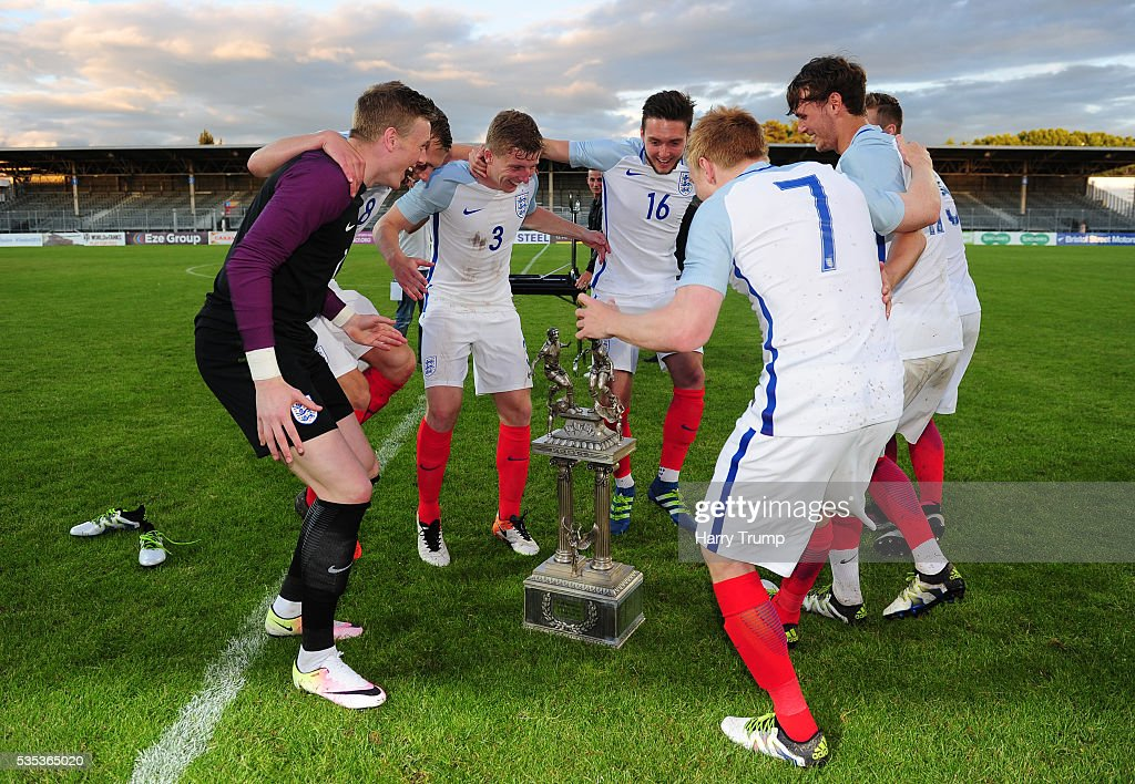 The England players dance around the trophy during the Final of the Toulon Tournament between England and France at Parc Des Sports on May 29, 2016 in Avignon, France.