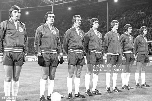 The England players line up for the national anthem before their vital World Cup Qualifier captain Martin Peters goalkeeper Peter Shilton Paul...