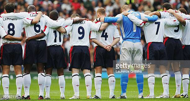 The England players pay their respects to murdered hostage Ken Bigley during the 2006 World Cup Qualifying match between England and Wales at Ols...