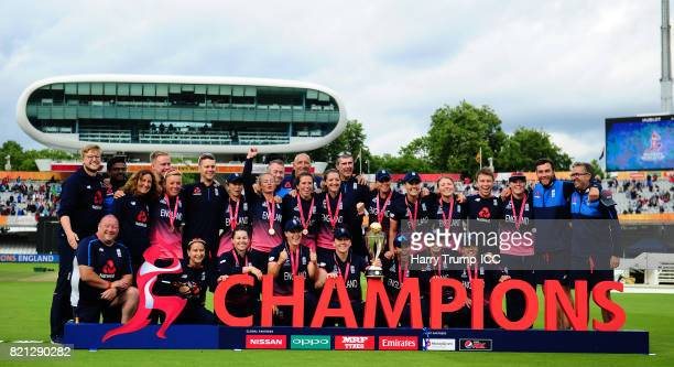 The England playing staff and coaches pose for a winning photo during the ICC Women's World Cup 2017 Final between England and India at Lord's...
