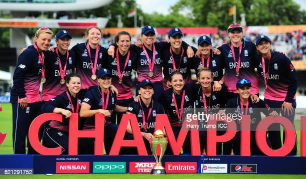 The England side pose with the trophy during the ICC Women's World Cup 2017 Final between England and India at Lord's Cricket Ground on July 23 2017...
