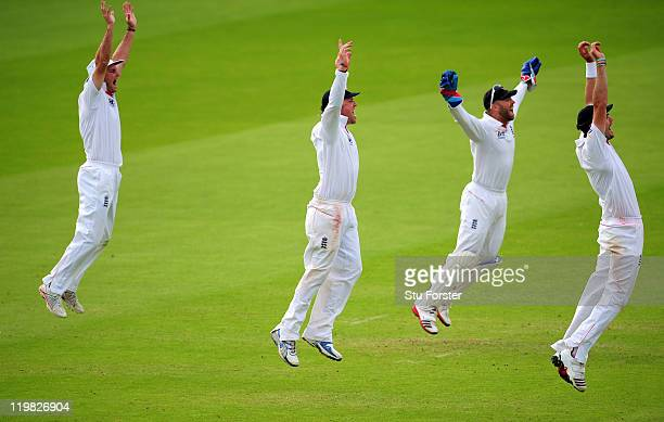 The England slip corden of Andrew Strauss Graeme Swann Matt Prior and James Anderson celebrate the final wicket of the India innings of Ishant Sharma...