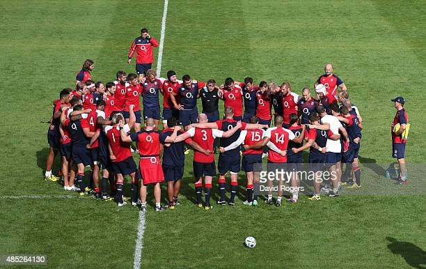 The England squad gather for their last team huddle before the annoucement of the 2015 Rugby World Cup squad during the England training session held...