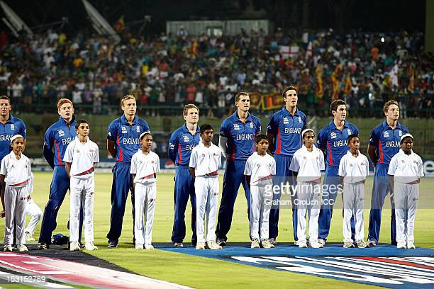 The England squad stand for the national anthems before the Super Eights Group 1 match between England and Sri Lanka at Pallekele Cricket Stadium on...