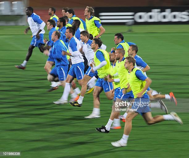 The England squad warm up during the England training session at the Royal Bafokeng Stadium on June 11 2010 in Rustenburg South Africa