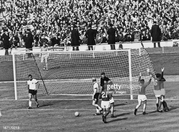 The England team celebrate after Geoff Hurst scores the controversial third goal against West Germany during the World Cup final at Wembley Stadium...