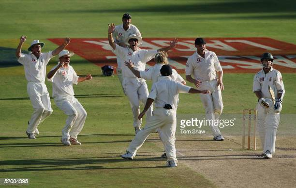 The England team celebrate as Matthew Hoggard of England takes the final wicket of Dale Steyn of South Africa during day five of the 4th Test between...