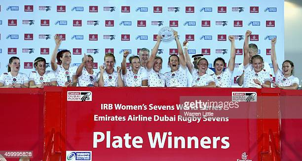 The England team celebrate as Plate winners during the IRB Women's Sevens World Series Cup Final on December 5 2014 in Dubai United Arab Emirates